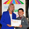 Cllr Patricia Stewart with Alex Mullan, Willow Park Boys Primary School.<br /> Photograph: Margaret Brown<br /> Primary Schools Drawing Competition, Prize giving Ceremony took place in the Assembly Room, County Hall at 4.30pm Wednesday 15 October 2014 as part of Social Inclusion Week 2014.