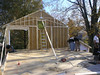 Gable end wall with a Scissors Truss applied to wall and temp. brace set in place.