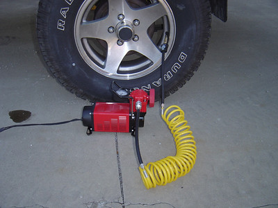 Q-MAXX MF1052 - 12 volt High volume air (2.54CFM) compressor. It comes with a  16' hose, 8' power cord and case (Not shown).  This is a better air compressor to pump up tires.