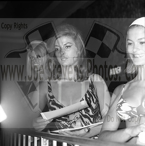 A bikini beach party of gals passing out flyers to promote the Wyandotte Theatre Birthday Partys for adults with no doubt somebody famous to appear or a group singing. on that day, muscle beach movie star, Bone Head (Jody McCrea) was there signing autographs.