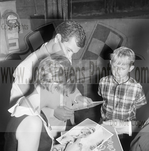 "In this photo, Dwayne Hickman & Deborah Walley sign autographs.  ""Ski Party"" was a movie that Dwayne Hickman (Dobie Gillis) & Deborah Walley were in. The movie came out in 1965. Here, in this series of photo's that Joe Stevens captured at the Wyandotte, MI Theater are of Dwayne Hickman & Deborah Walley on a tour performance promoting their movie ""Ski Party"". Frankie Avalon was also in the movie playing the ski instructor and this movie, being one in the last of the Muscle Beach type movies. Leslie Gore & James Brown performed their hit songs in ""Ski Party"" too. Now Wyandotte Theater in Southeast Michigan, was host to many big movie starts throughout the silver screen era up until the 60's & 70's until it was torn down in the 90's. Across the street though the city street long hotel still stands that use to house the actors & singers overnight where they were entertained in the night clubs within. Wyandotte is known for having the most bars & nightclubs than any other city in MI & competing with other states. I have photo's of other stars in this gallery too but while your looking at Dobie Gillis & Deborah, also check out this trailer I found on U-Tube of the movie ""Ski Party"" in which they were promoting in these photo's. http://youtu.be/HZo954DwLhA"
