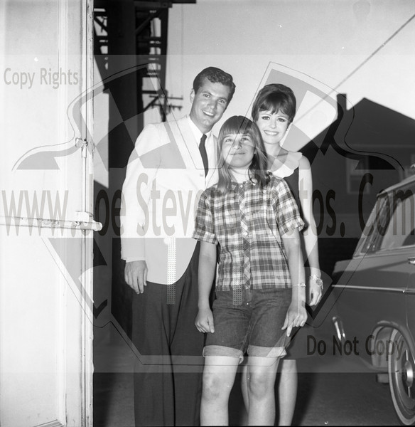 "This photo is of my sister Chris Stevens (Emery) posing with TV Stars Dwayne Hickman & Deborah Walley of the Dobie Gillis Show & Mother-in-Laws.  This was taken in the alley behind the Wyandotte Theatre in Michigan where Dwayne & Deborah were making a tour appearance promoting their new movie ""Ski Party"" in 1965.  ""Ski Party"" was a movie that Dwayne Hickman (Dobie Gillis) & Deborah Walley were in. The movie came out in 1965. Here, in this series of photo's that Joe Stevens captured at the Wyandotte, MI Theater are of Dwayne Hickman & Deborah Walley on a tour performance promoting their movie ""Ski Party"". Frankie Avalon was also in the movie playing the ski instructor and this movie, being one in the last of the Muscle Beach type movies. Leslie Gore & James Brown performed their hit songs in ""Ski Party"" too. Now Wyandotte Theater in Southeast Michigan, was host to many big movie starts throughout the silver screen era up until the 60's & 70's until it was torn down in the 90's. Across the street though the city street long hotel still stands that use to house the actors & singers overnight where they were entertained in the night clubs within. Wyandotte is known for having the most bars & nightclubs than any other city in MI & competing with other states. I have photo's of other stars in this gallery too but while your looking at Dobie Gillis & Deborah, also check out this trailer I found on U-Tube of the movie ""Ski Party"" in which they were promoting in these photo's. <a href=""http://youtu.be/HZo954DwLhA"">http://youtu.be/HZo954DwLhA</a>"