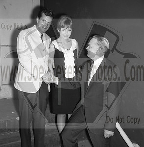 "Dobie Gillis (Dwayne Hickman) & Deborah Walley posing with the owner of the Wyandotte Theatre, Howard Denial.  .""Ski Party"" was a movie that Dwayne Hickman (Dobie Gillis) & Deborah Walley were in. The movie came out in 1965. Here, in this series of photo's that Joe Stevens captured at the Wyandotte, MI Theater are of Dwayne Hickman & Deborah Walley on a tour performance promoting their movie ""Ski Party"". Frankie Avalon was also in the movie playing the ski instructor and this movie, being one in the last of the Muscle Beach type movies. Leslie Gore & James Brown performed their hit songs in ""Ski Party"" too. Now Wyandotte Theater in Southeast Michigan, was host to many big movie starts throughout the silver screen era up until the 60's & 70's until it was torn down in the 90's. Across the street though the city street long hotel still stands that use to house the actors & singers overnight where they were entertained in the night clubs within. Wyandotte is known for having the most bars & nightclubs than any other city in MI & competing with other states. I have photo's of other stars in this gallery too but while your looking at Dobie Gillis & Deborah, also check out this trailer I found on U-Tube of the movie ""Ski Party"" in which they were promoting in these photo's. http://youtu.be/HZo954DwLhA"