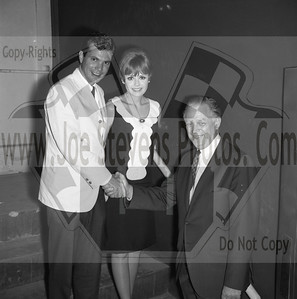 "Dwayne Hickman (Dobie Gillis Show) & Deborah Walle posing with Howard Denial, the owner of the Wyandotte Theater.  ""Ski Party"" was a movie that Dwayne Hickman (Dobie Gillis) & Deborah Walley were in. The movie came out in 1965. Here, in this series of photo's that Joe Stevens captured at the Wyandotte, MI Theater are of Dwayne Hickman & Deborah Walley on a tour performance promoting their movie ""Ski Party"". Frankie Avalon was also in the movie playing the ski instructor and this movie, being one in the last of the Muscle Beach type movies, Leslie Gore & James Brown performed their hit songs of the time too. Now Wyandotte Theater in Southeast Michigan, was host to many big movie starts throughout the silver screen era up until the 60's & 70's until it was torn down in the 90's. Across the street though the city street long hotel still stands that use to house the actors & singers overnight where they were entertained in the night clubs within. Wyandotte is known for having the most bars & nightclubs than any other city in MI & competing with other states. I have photo's of other stars in this gallery too but while your looking at Dobie Gillis & Deborah, also check out this trailer I found on U-Tube of the movie ""Ski Party"" in which they were promoting in these photo's. http://youtu.be/HZo954DwLhA"