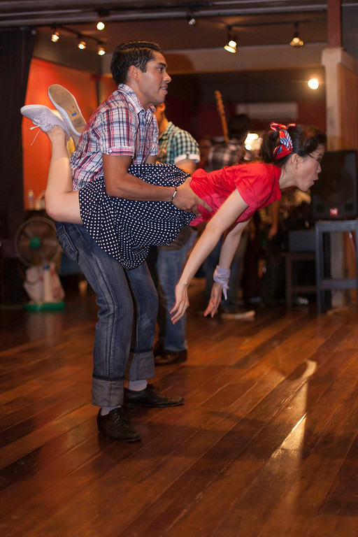 """After the organised event, enthusiasts get down to some of the more energetic """"big swings"""". """"Billy Blues"""": Rockabilly and Blues Party at The Hop - Swing Dance Club, Silom, Bangkok."""