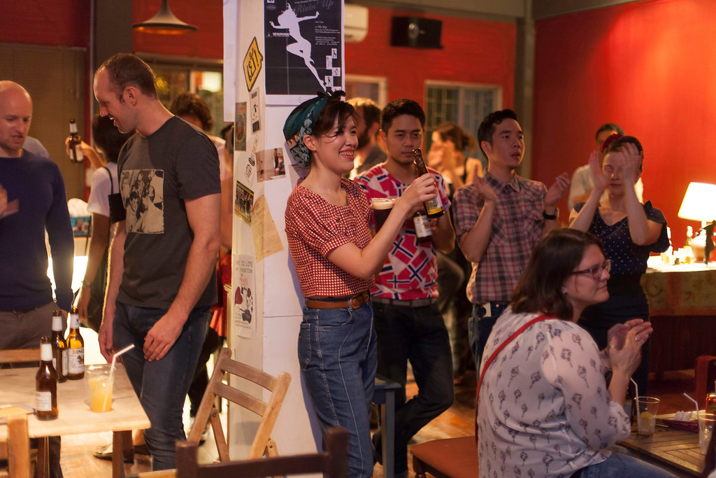 """Off the dancefloor, drop-in dancers and regulars enjoy the show. """"Billy Blues"""": Rockabilly and Blues Party at The Hop - Swing Dance Club, Silom, Bangkok."""