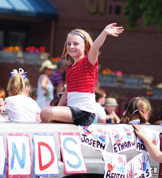 A future beauty queen waves on a float at the Bellevue, KY Memorial Day parade 2012.