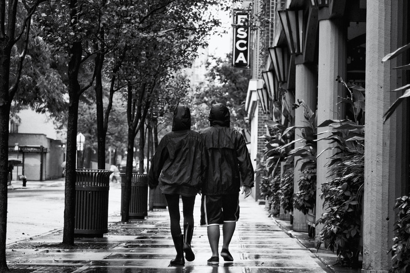 A couple walks, hand-in-hand, down the street in the hours before Hurricane Irene's arrival.