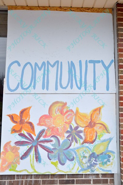 Residents from Ferguson and surrounding areas come together on 12/6/14 to beautify the town by painting the boards that stores put up for security to protect against riots and looting after the grand Jury decided not to indite Officer Wilson for the killing of Michael Brown.
