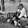 Mexico Nogales Vendor with Sleeping Child April 2008