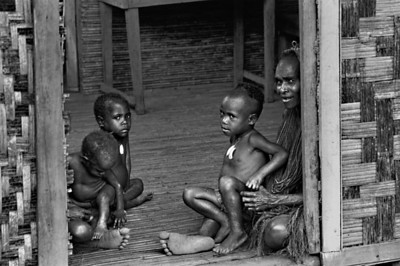 Family in Doorway Papua New Guinea 1970 12 X 8Black and White                                                                         Exhibit opens November 1, 2013, Central Bank - Lexington KY