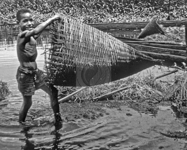 Papua New Guinea - Boy with Fish Trap