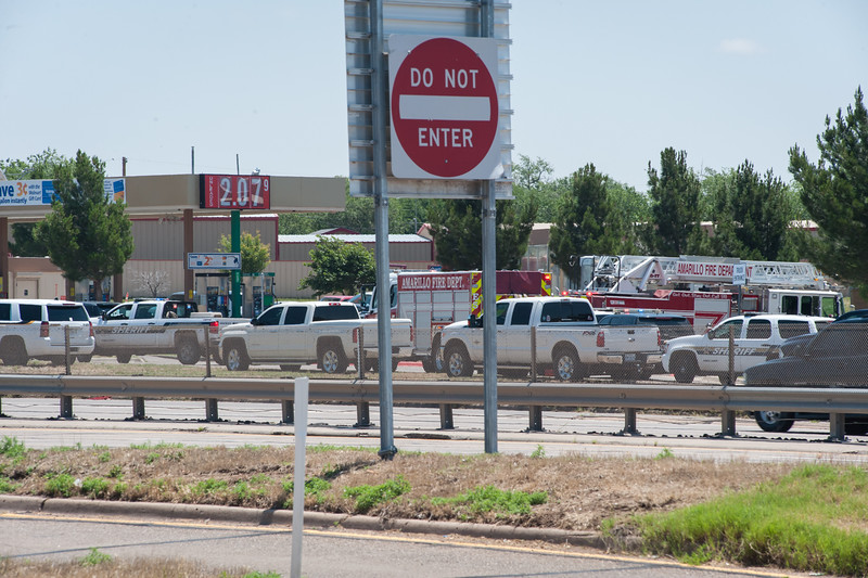 Shaie Williams freelance photographer . Man with gun takes his boss hostage after firing a shot in Walmart located at Interstate 27 and Georgia Amarillo, TX  on June 14, 2016. shooter was shot and killed during the standoff with local law enforcement. No hostages were harmed. Police officers found holster and ammunition in his vehicle along with Arabic writings.