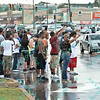 """Protesters rally peacefully while cars go by honking showing their support during the second day of protests in Ferguson Missouri on West Florissant in front of the QT that was burned to ruins the night before during the riot.  Protesters are upset over the shooting of """"unarmed"""" Michael Brown an 18 year old black male by a member of the Ferguson Police Department."""