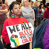 """DeAnndra Murry holds a sign and intensely wathes and listens during The Reenactment of the March on Washington, """"I Have a Dream"""" speech from Dr. Martin Luther King Jr. Perfrormed by Amarillo's Julian Reese at the JBK Student Center on WTAMU campus in Canyon, TX. January 22, 2018. [Shaie Williams for Amarillo Globe News]"""