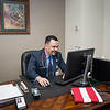 Dr. Mohammed Bahaa Aldeen served as a cultural advisor for USMC Civil Affairs Team CA2 2/11 during the Iraq war. Pictured next to an American flag signed by the team he served with. [Shaie Williams for Amarillo Globe News]