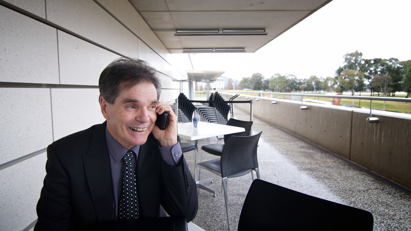 Ron Williams takes a rare break from court proceedings and media interviews to call his wife and children in Towoomba.
