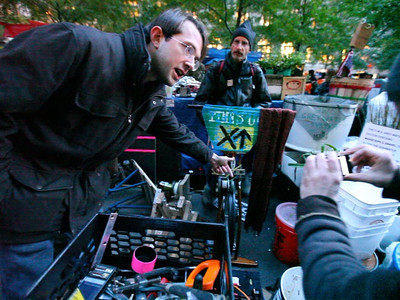 The Fire department confiscated all generators in the area. The protestors were using them to prepare food, and charge their cell phones & laptops. ... So -- the engineering minds among them built these human-powered generators. Click Play to hear the explanation.