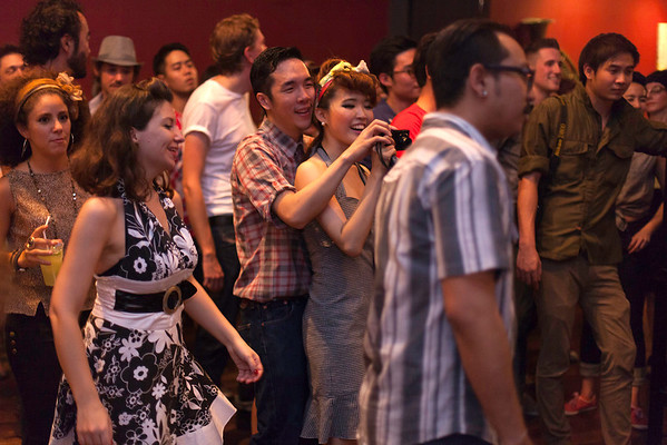 """Founder/Director Oat Naviroj and Partner/Club Manager Young Ji Kim take time out to enjoy night's entertainments. """"Billy Blues"""": Rockabilly and Blues Party at The Hop - Swing Dance Club, Silom, Bangkok."""