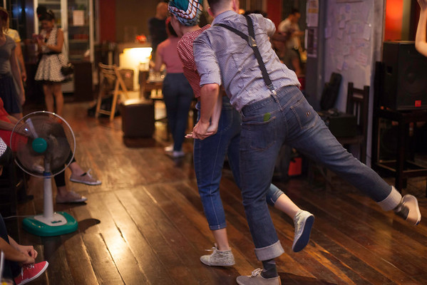 """Swing dance is a social exercise - dancers trade partners throughout the night. """"Billy Blues"""": Rockabilly and Blues Party at The Hop - Swing Dance Club, Silom, Bangkok."""