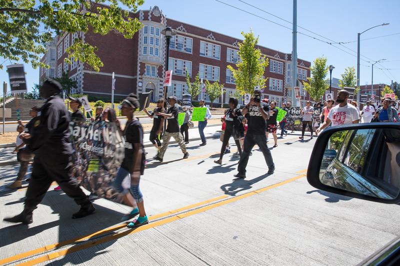 A march on July 29, 2017 (passing by Earl's Cuts and Styles) protesting the killing of Charleena Lyles by Seattle police.