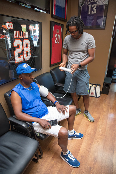 Getting blood pressure checked by a friend at Earl's Cuts and Styles