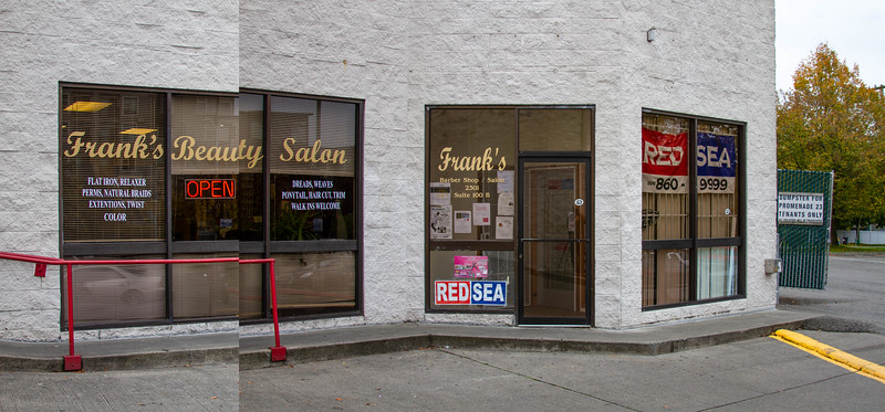 "The historical location of Frank's Barber Shop and Beauty Salon in the ""Promenade 23"" shopping center at the intersection of 23rd and Jackson in Seattle's Central District - it has recently been redeveloped by the Paul Allen Company ""Vulcan"".  The large site, previously occupied by many small african-american owned businesses was purchased for $30.9 million."