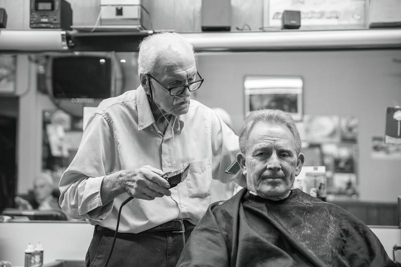Guy cutting Rick's hair
