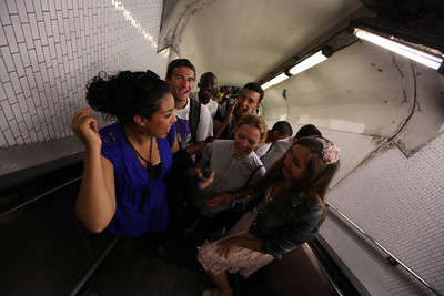 soccer fans chanting on their way through the subway system