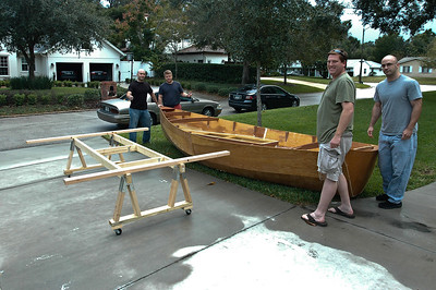 I got my son-in-law with three of his weight lifting friends to move the boat off the stands. Another set of stands were made to place the boat upside down on to finish the hull.