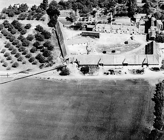 <center><font size=3><u> - Aerial Photo Crowmarsh Battle Farm Barns - 20 May 1944 </u></font> (BS0374)  Shows damaged corner where Lancaster bomber overshot the runway and hit the barns. </center>