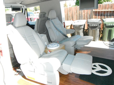 Rear-Facing Leather recliners with built in seat belts for the kids.