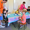 Jacoby Zimei, 8, of Leominster joins in Dog Days Craft Time at the Leominster Public Library on Monday.  SENTINEL & ENTERPRISE JEFF PORTER