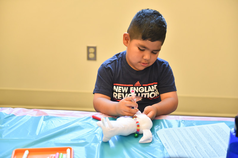 Luka Calderon, 4, of Leominster decorates a stuffed dog during the Dog Days Craft Time held at the Leominster Public Library on Monday.  SENTINEL & ENTERPRISE JEFF PORTER