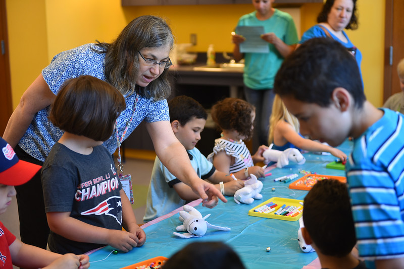 Leominster Childrens Library Associate Renee Wheeler teaches during the Dog Days Craft Time held at the Leominster Public Library on Monday.  SENTINEL & ENTERPRISE JEFF PORTER