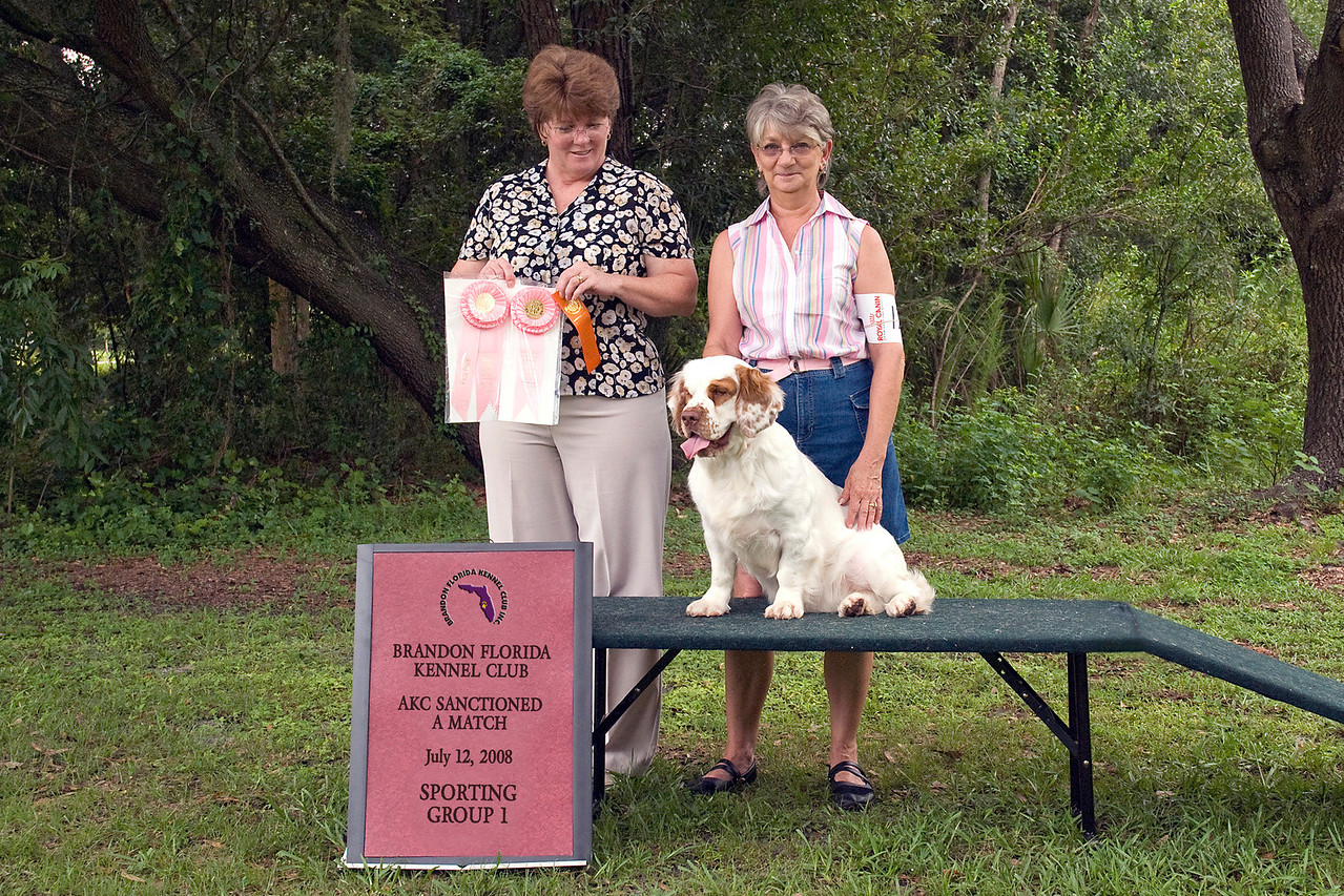 Casmir Ginger Snap, a Clumber Spaniel, is shown with Judge Teresa Gimbut and owner/handle Valerie Lovins, taking a Group 1 in the Sporting group.