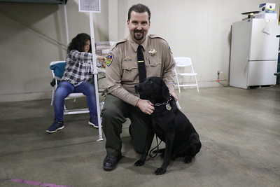Humboldt County Sheriff's Office K-9 handler Colby Henson and K-9 Louie at the 30th annual Dog Expo at Redwood Acres in Eureka on Sunday afternoon. (Hunter Cresswell - The Times-Standard)