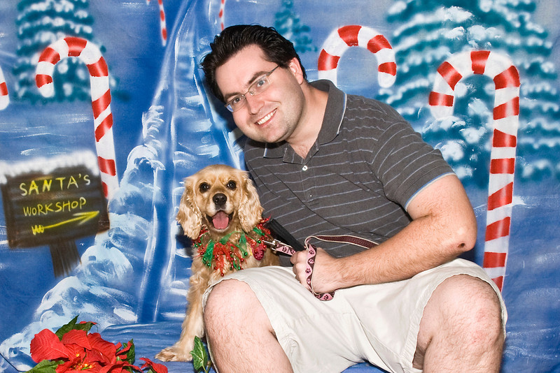 Candy, a Cocker Spaniel, poses with Ryan for their Christmas pictures.  She is owned and loved by Diana & Ryan Murillo.