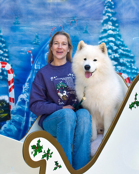 Kempas sits like a true Samoyed gentleman next to Stephanie.  Kempas is owned and loved by Stephanie Sagan & Roger Gabbey and shares them with his little brother, Koa.