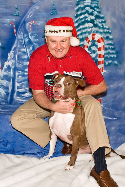 Moachaa, a Pit Bull, and Tim Rooney pose for their Christmas photo.