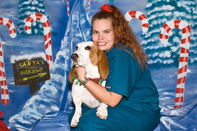 Myranda, a Basset Hound, and her owner Robyn Sadler pose for their Christmas picture.