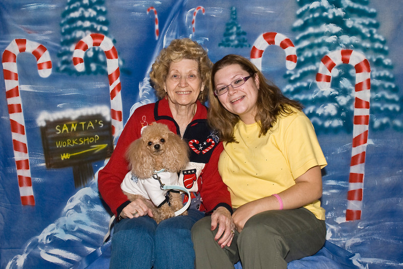 Pumpkin, an apricot Toy Poodle, poses with his best friends, Margaret & Jamie Jo Baker.