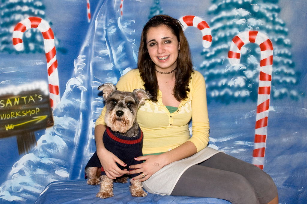 Fritz, a Miniature Schnauzer, poses with his best friend.  He is loved by the Renee Carlson family.