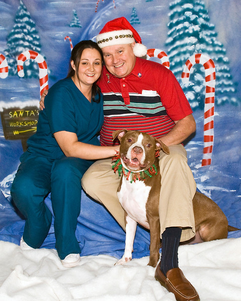 Jaclynn, her father Tim Rooney, and Moachaa, a Pit Bull, enjoy a Christmas moment.  (Picture sized for 8 x 10)