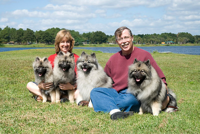 Wendy & Dave Kurtz pose with their Keeshonden, Kira, Sadie, Ziva & Tucker.