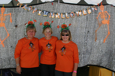 June, Jeanne, and Barb show off one of their matching outfits. They claim to have different matching shirts for every day of the trial.