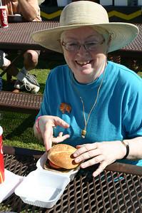 Nancy Marmol enjoys her hamburger.