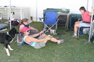 Bump, Karey, Katrina, and Kathy hang out at their crating area.