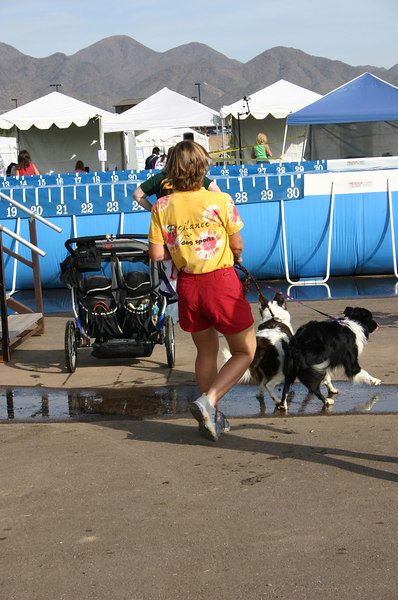 Sharon F heading from the agility area, past dock dogs, towards the crating area in the background.