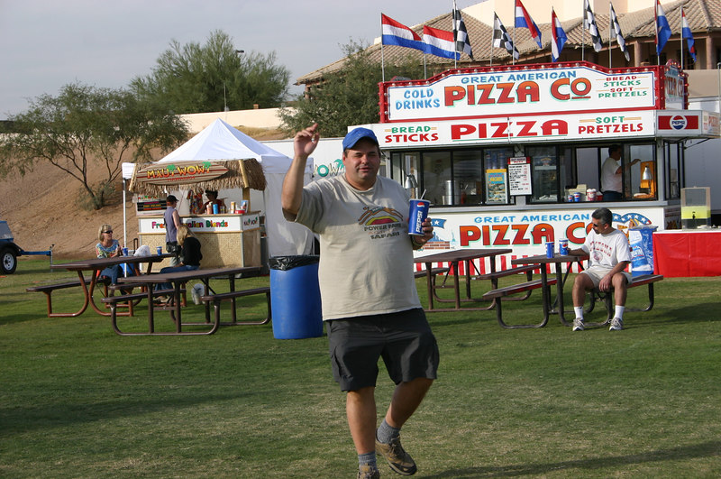 Terry L walking past some of the onsite gourmet dining.